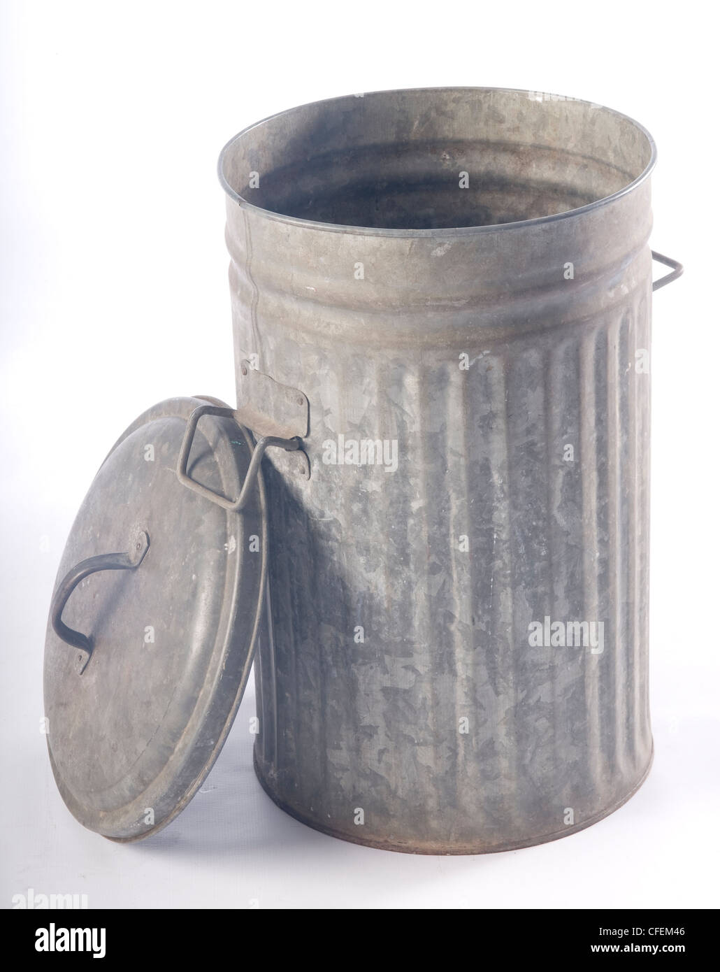 Old Open Corrugated Metal Garbage Bin With Lid Leaning