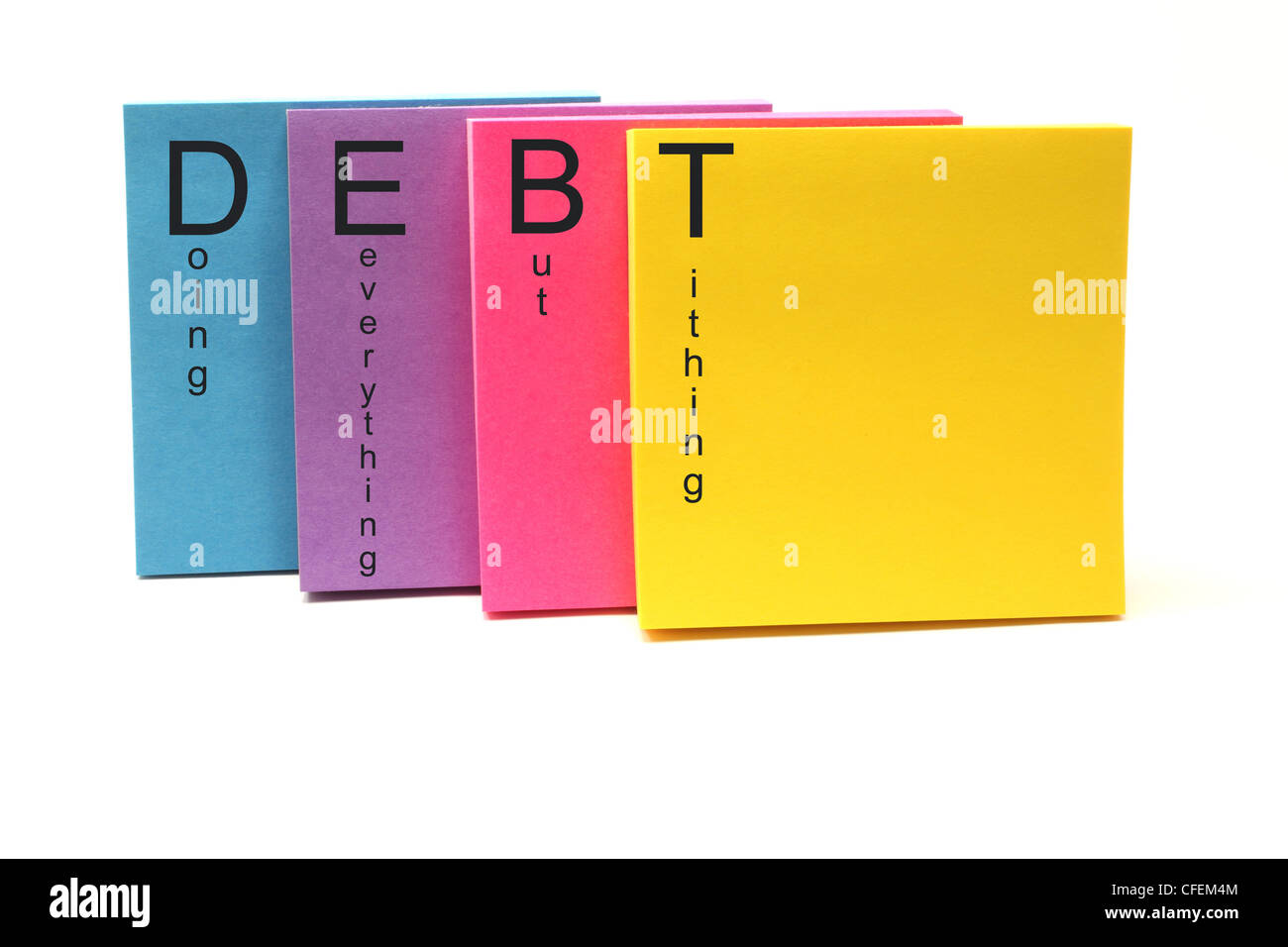 Colorful sticky notes with DEBT Doing Everything But Tithing acronym written on them. - Stock Image