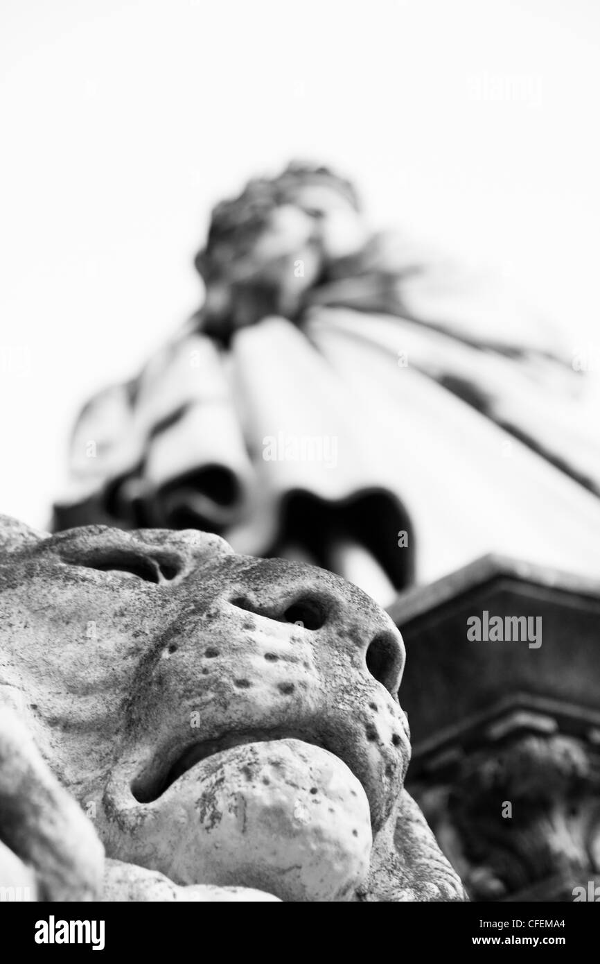 Detail of lions head with statue in background Florence Italy - Stock Image