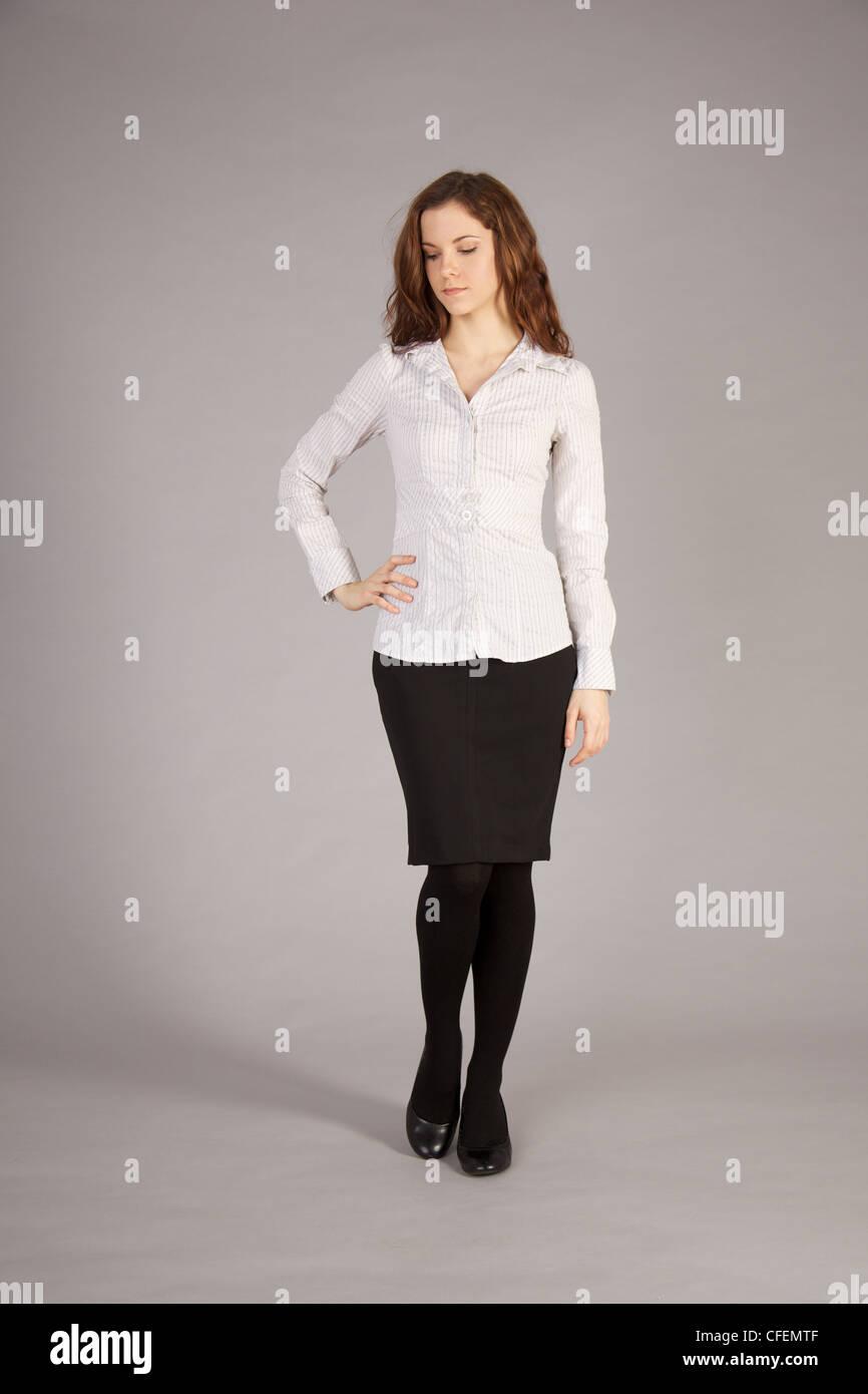 e0e28b821a Caucasian Petite Woman in White Blouse and Black Skirt Stock Photo ...