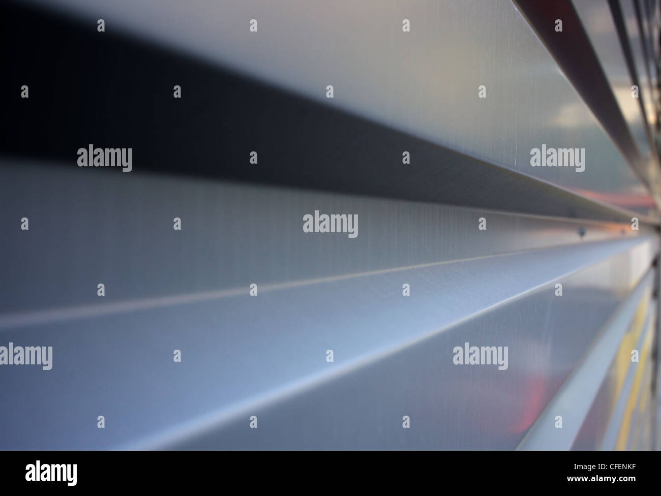 Rectangular corrugation of a steel or aluminum wall in diminishing perspective to the right Stock Photo