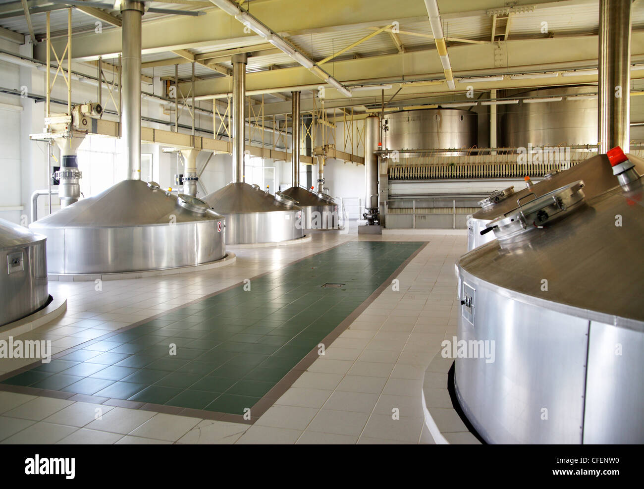 Modern brewery - workshop with steel fermentation vats - Stock Image