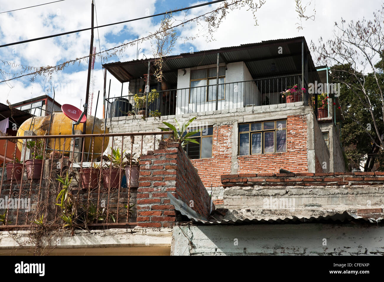 substantial middle class Mexican hillside duplex on Cerro del Fortin overlooking Oaxaca de Juarez on beautiful spring - Stock Image