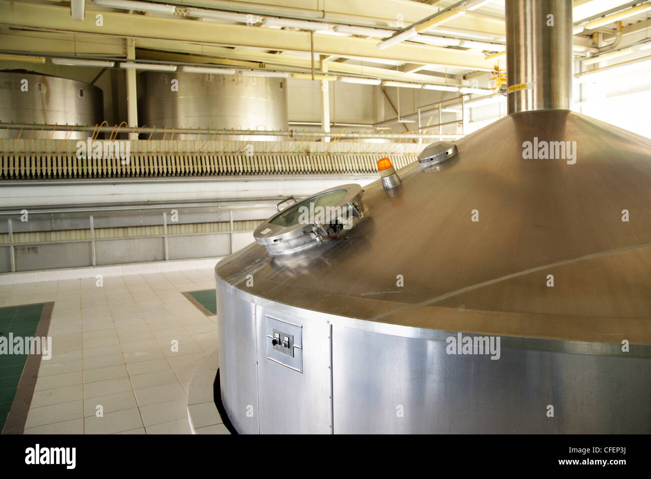 Modern brewery - workshop with steel fermentation tanks - Stock Image