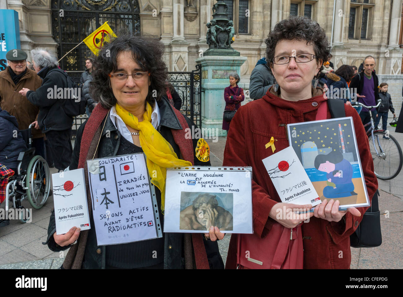 Paris, France, Anti Nuclear Power Activists Demonstrating on Anniversary of Fukushima Disaster, Women Holding signs, - Stock Image