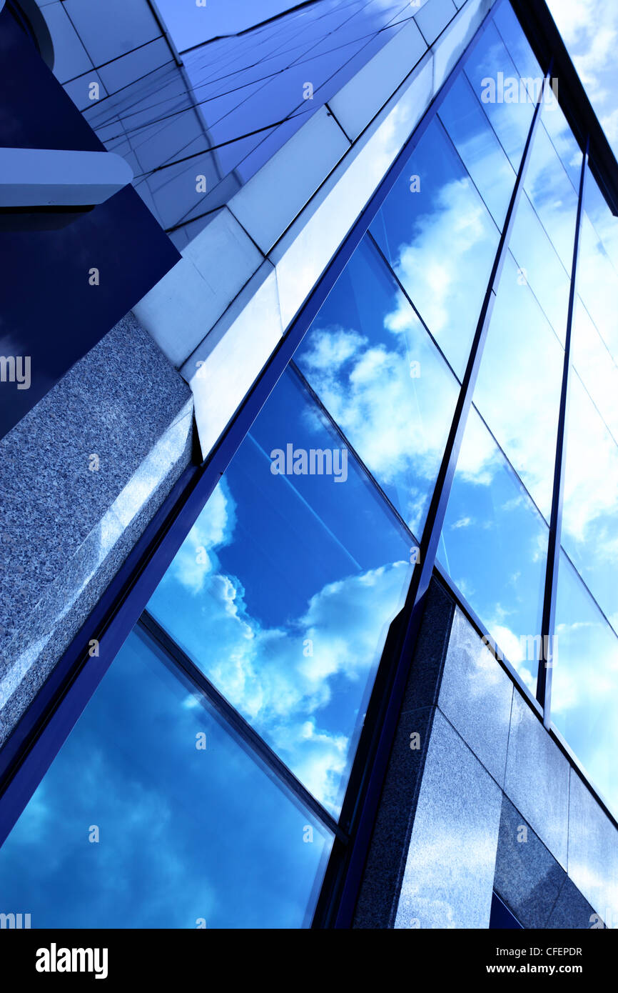 Glass wall of business center and sky reflection, may be used as background - Stock Image