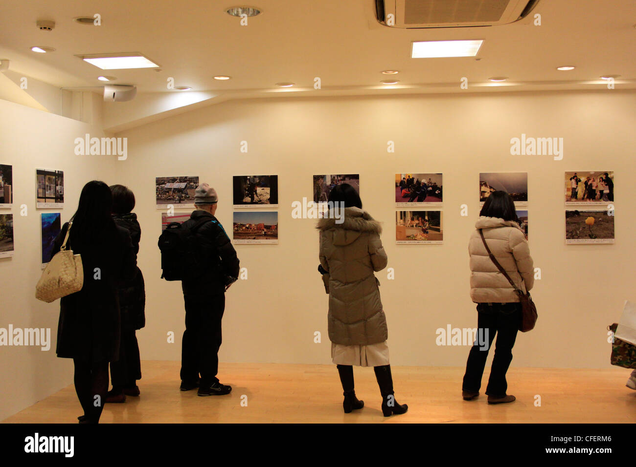Japan marked one year since the earthquake and tsunami on March 11, 2011. The photo exhibition of the disaster area. - Stock Image