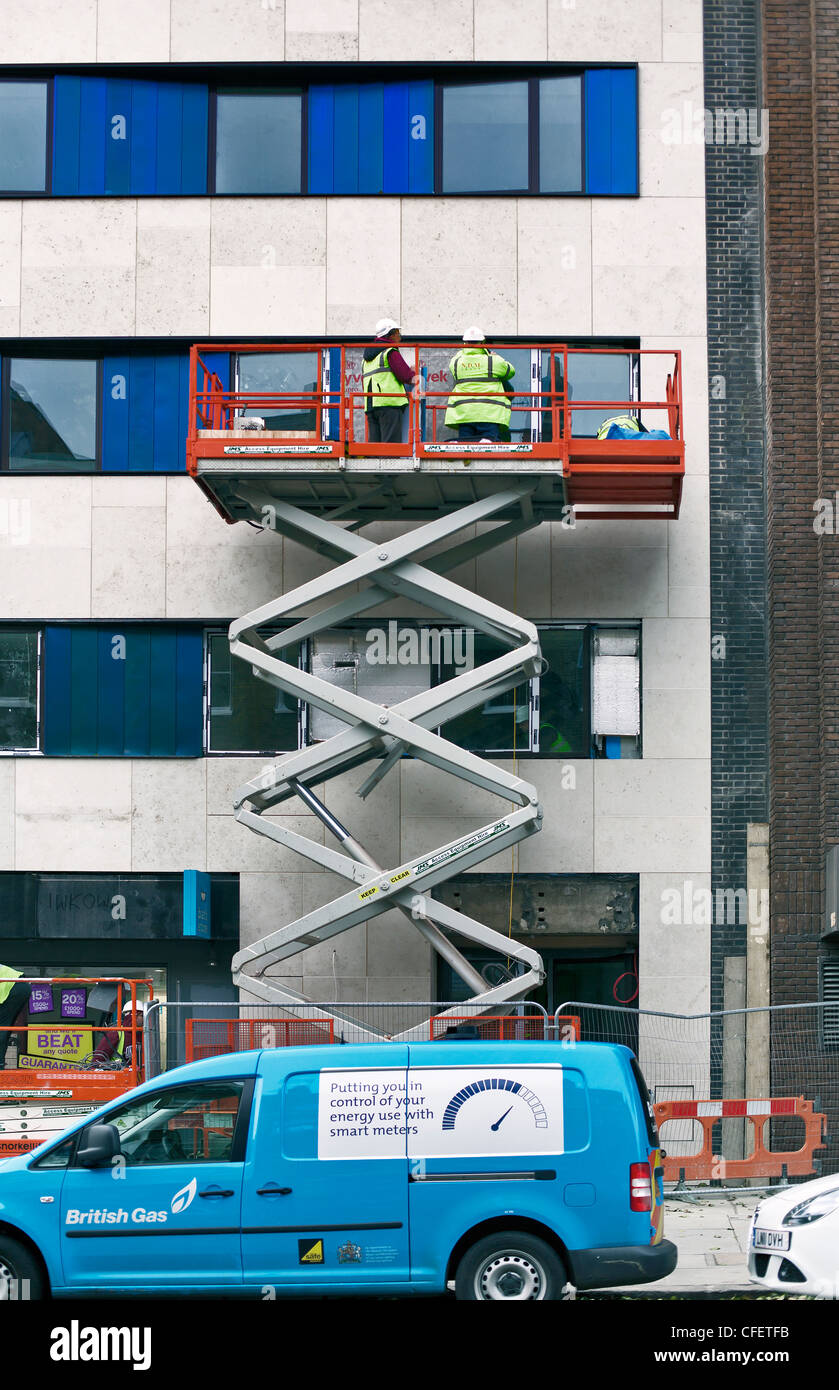 Mobile elevating work platform in use on external building refurbishment, Baker Street, London, England; UK; Europe - Stock Image