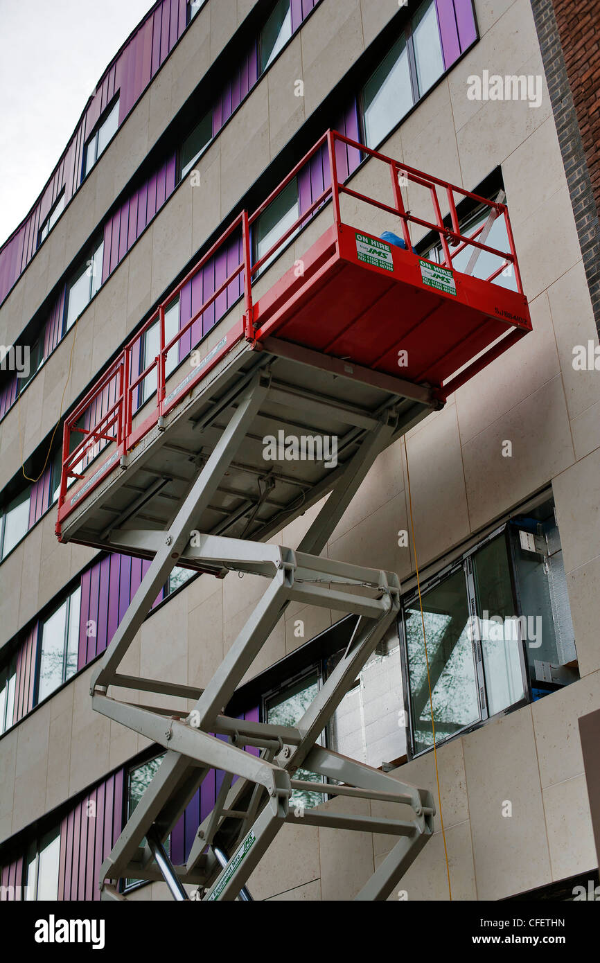 Mobile elevating work platform in use on external building refurbishment, Stock Photo