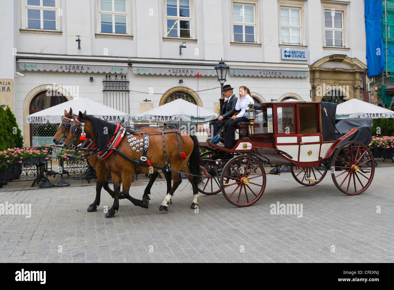 Horse drawn carriages, Main Market Square, Old Town, Krakow, Cracow, Malopolska Province, Lesser Poland Voivodeship, - Stock Image