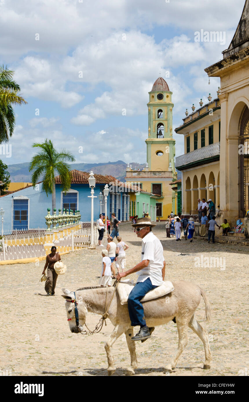 Old man on a donkey, Trinidad, UNESCO World Heritage Site, Cuba, West Indies, Caribbean, Central America Stock Photo