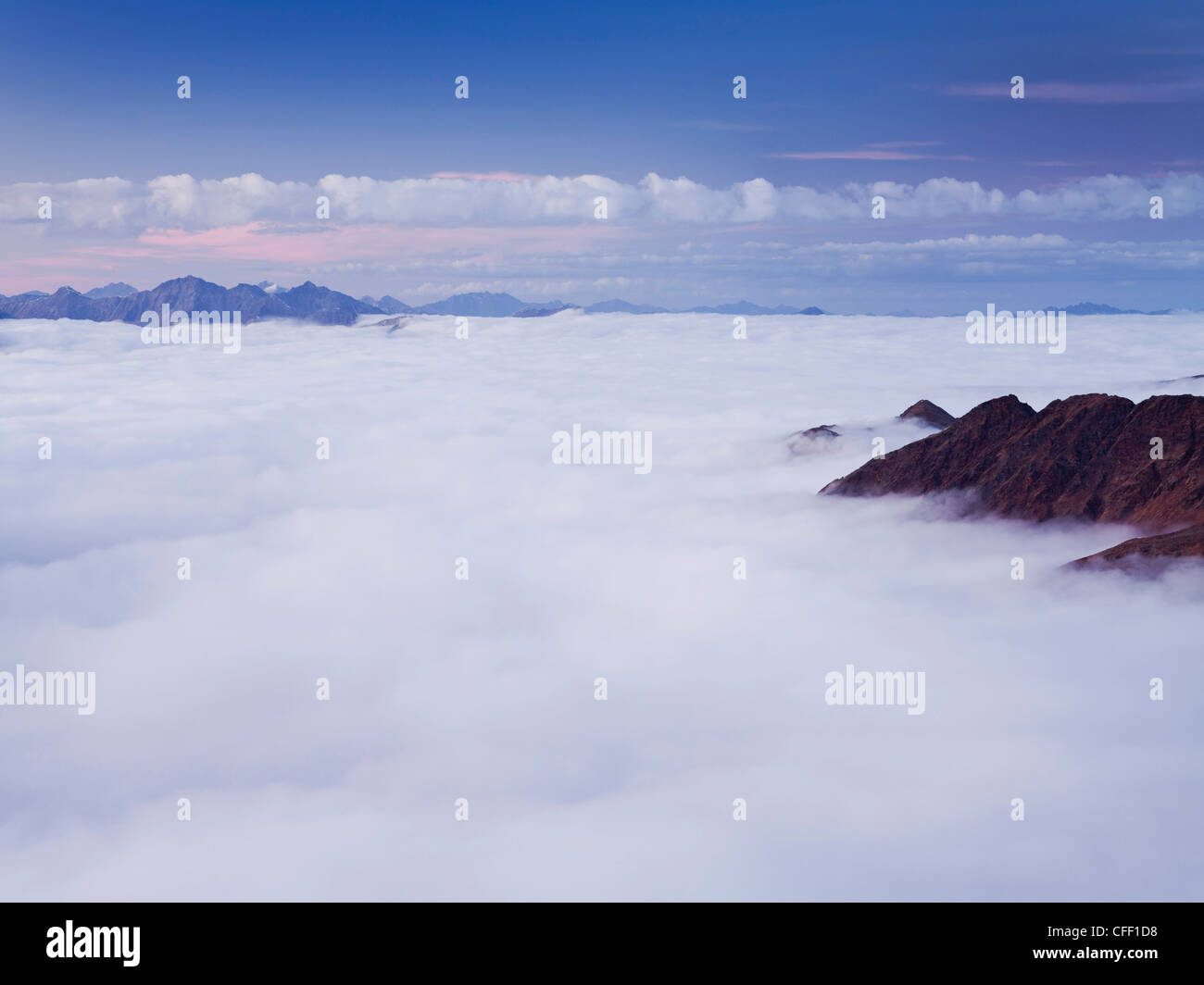View from Monte Scorluzzo onto sea of clouds at sunset, Stilfser Hock National Park, Lombardy, Italy, Europe - Stock Image