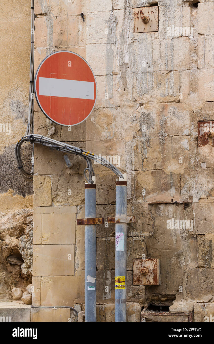 Typically Sicillian mix of crumbling and partially-repaired masonry, tangled electric cables, reinforcing plates - Stock Image
