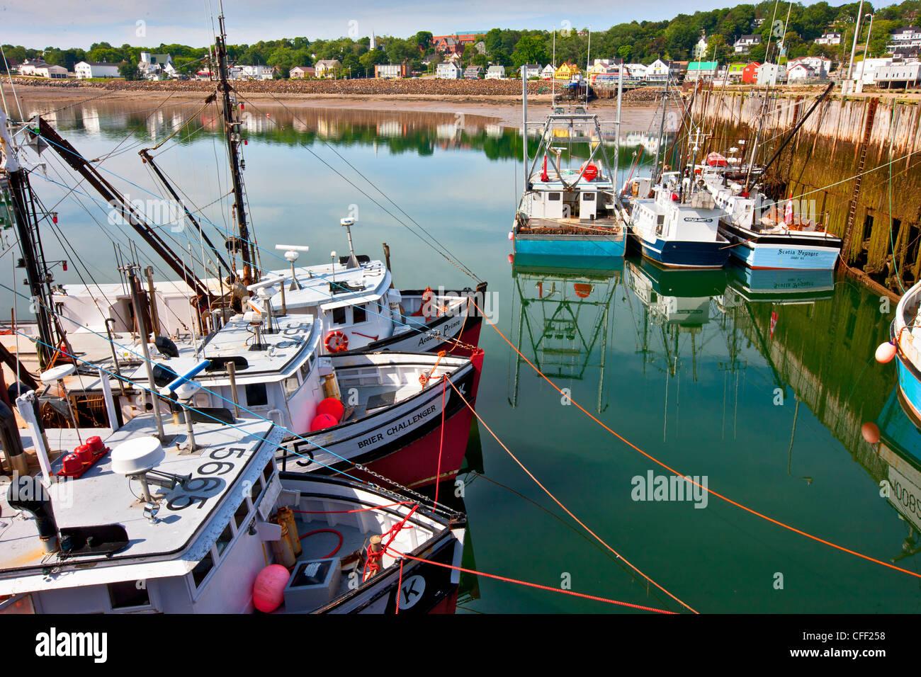Fishing boats tied up at wharf, Digby, Nova Scotia, Canada - Stock Image