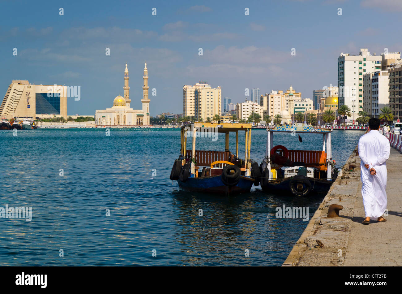 Sharjah Creek, Corniche Mosque and Radisson Blu Resort Hotel, Sharjah, United Arab Emirates, Middle East - Stock Image