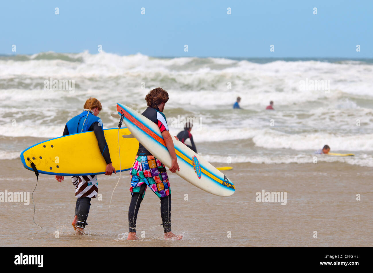 Surfers, Polzeath Beach, Cornwall, England, United Kingdom, Europe - Stock Image