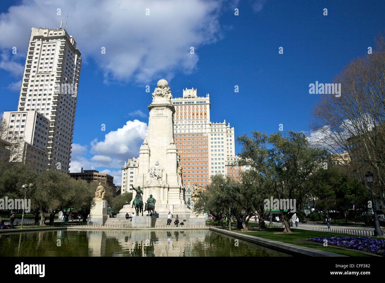 Spring sunshine on the Plaza de Espana, with statues of Don Quixote and Sancho Panza, Madrid, Spain, Europe - Stock Image