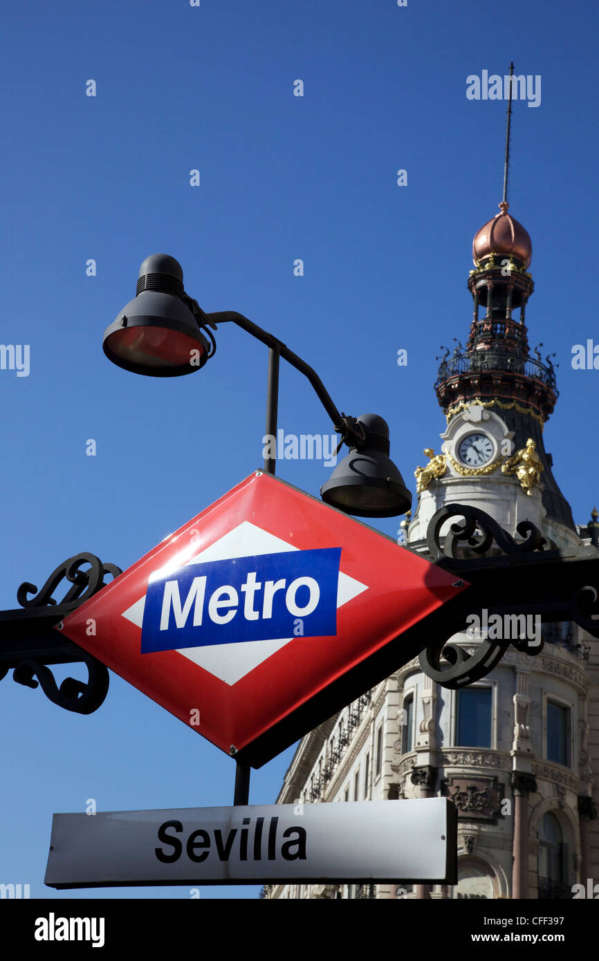 Sevilla Metro station sign in front of the Banco Espanol de Credito building, Madrid, Spain, Europe - Stock Image