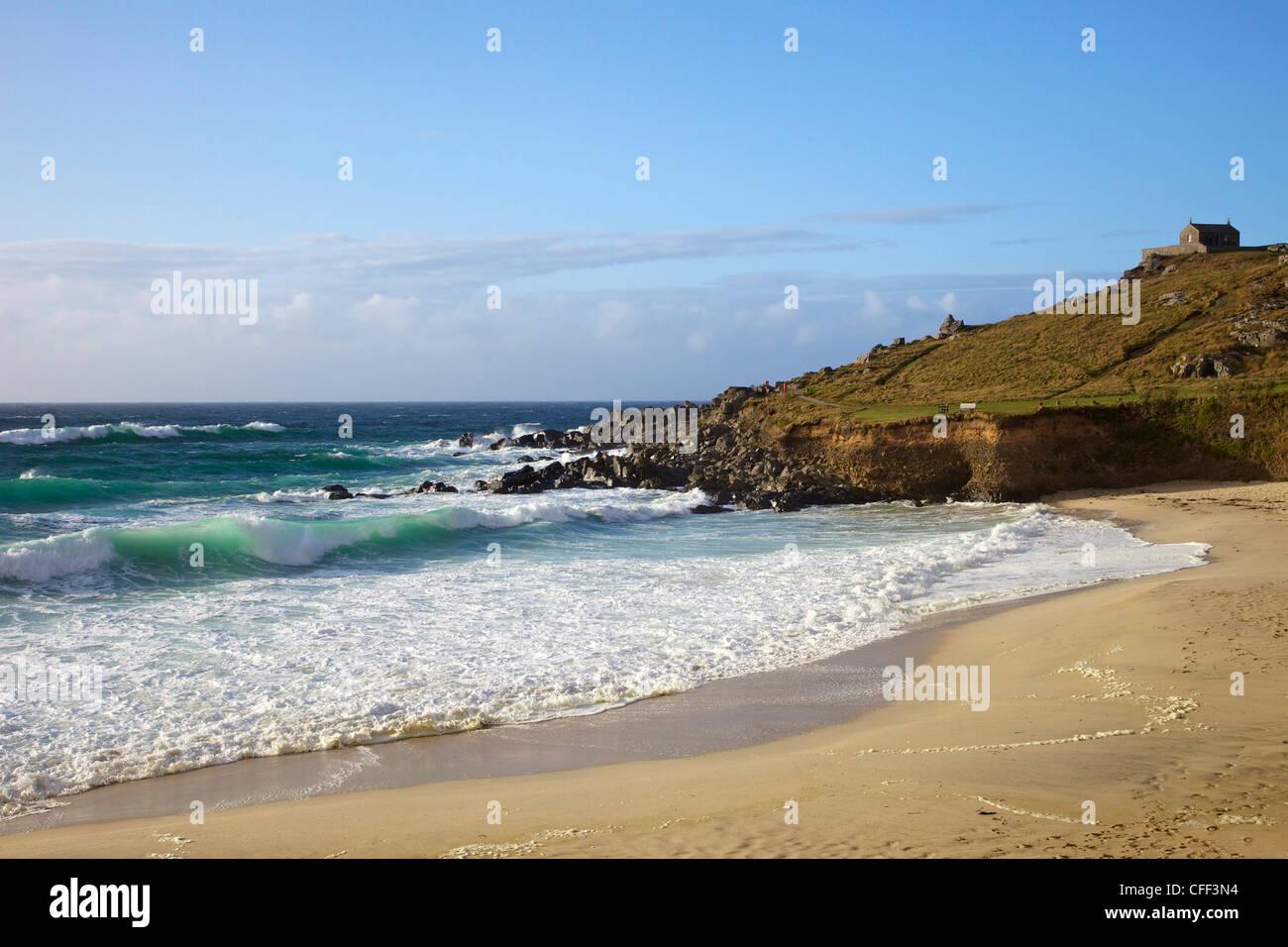 Surf in sea off Porthmeor beach in evening sun, St. Nicholas chapel on the island, St. Ives, Cornwall, England, Stock Photo