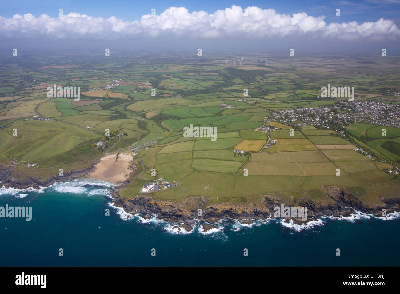 Aerial view of Poldhu Cove and Mullion, looking east to Goonhilly, Lizard Peninsula, in summer sun, Cornwall, England, - Stock Image