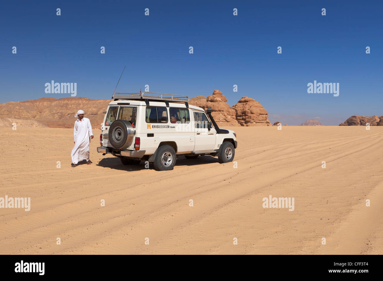 Jeep safari in the Sinai desert with bedouin driver, Egypt. - Stock Image