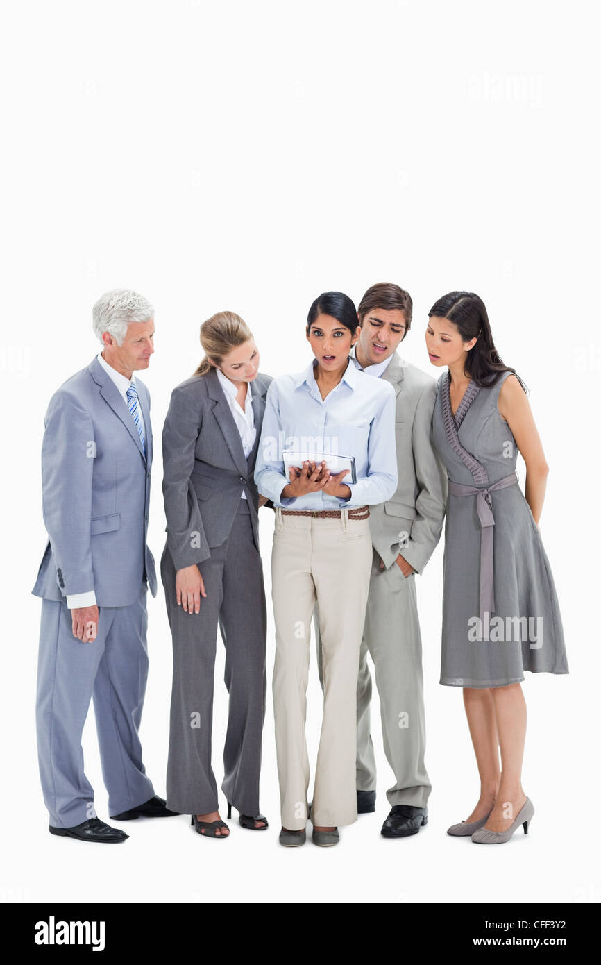 Speechless business people watching a touchpad - Stock Image