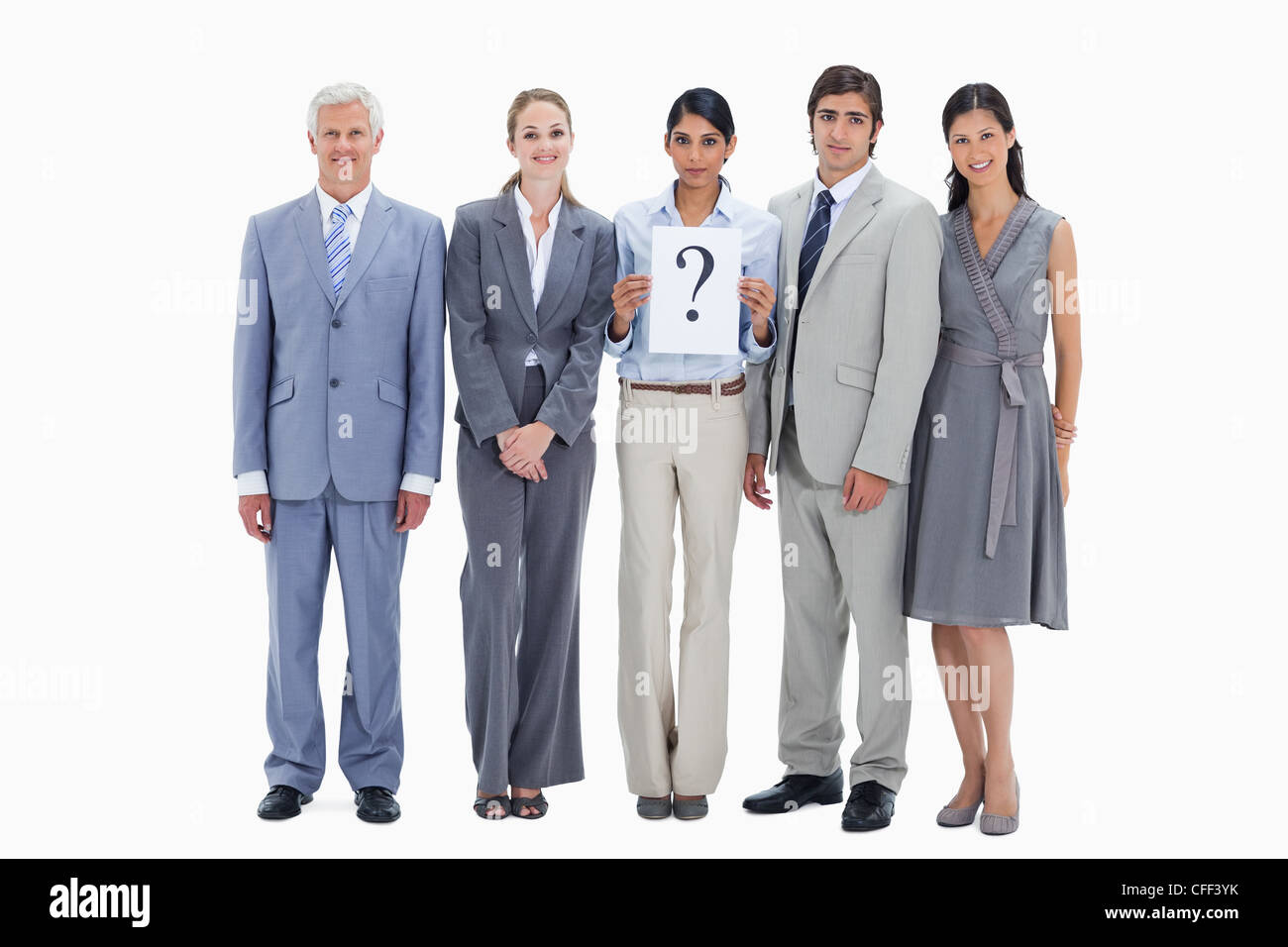 Business team holding a sign of a question mark - Stock Image