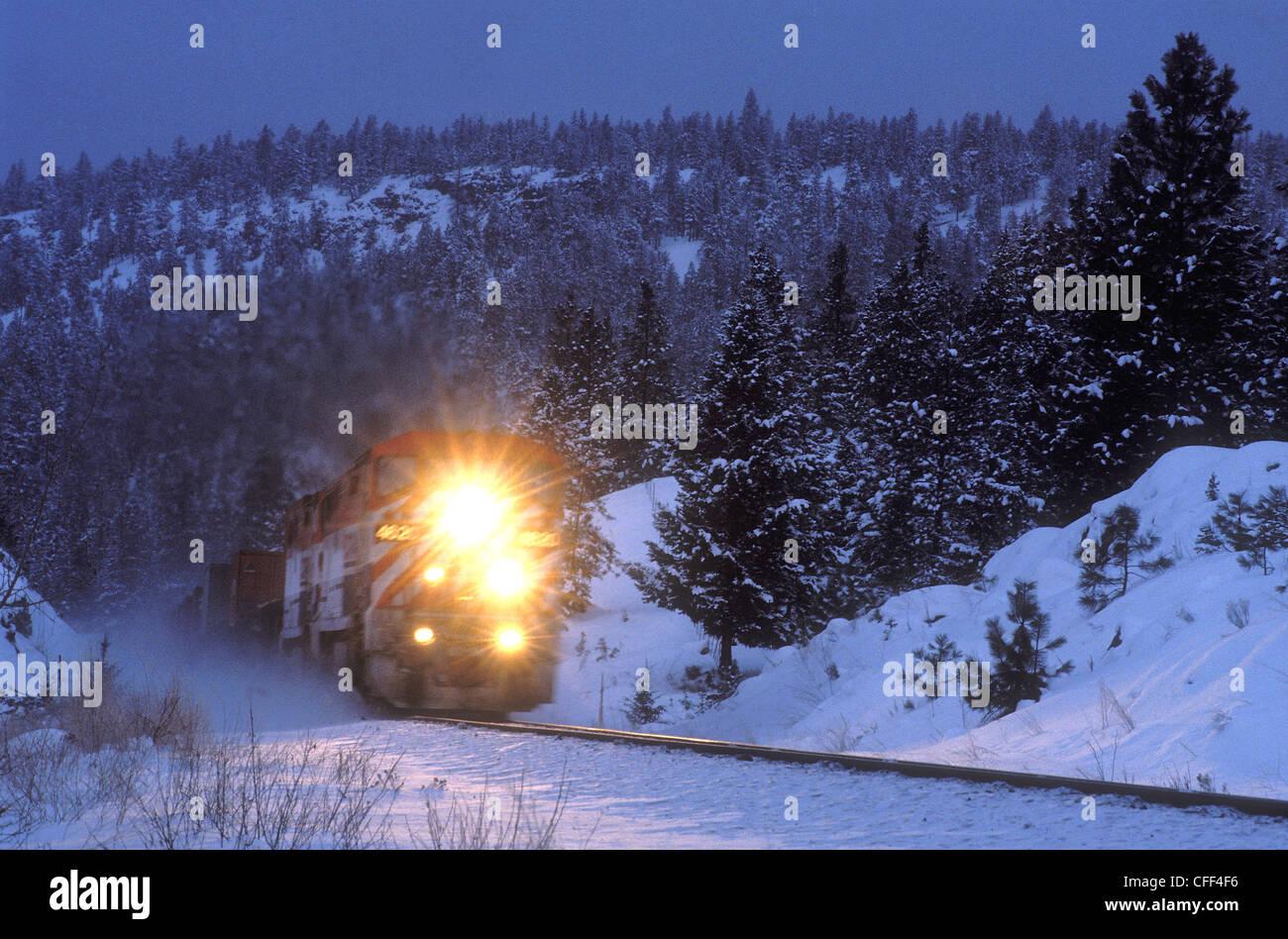 BC Rail freight train travels through the night, British Columbia, Canada. - Stock Image