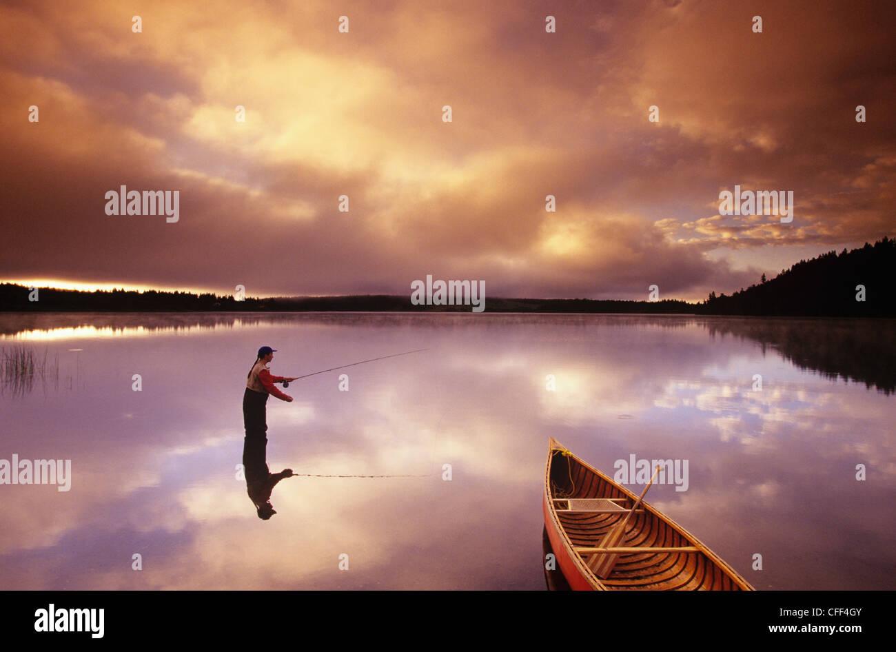 fly fishing on 108 Mile Lake, British Columbia, Canada. Stock Photo