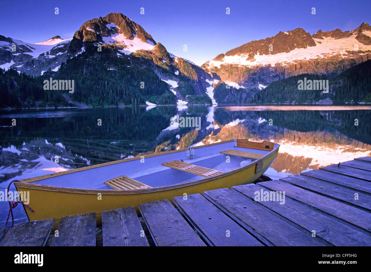 Rowboat Alpine Club Canadcabin dock Lake Lovely - Stock Image