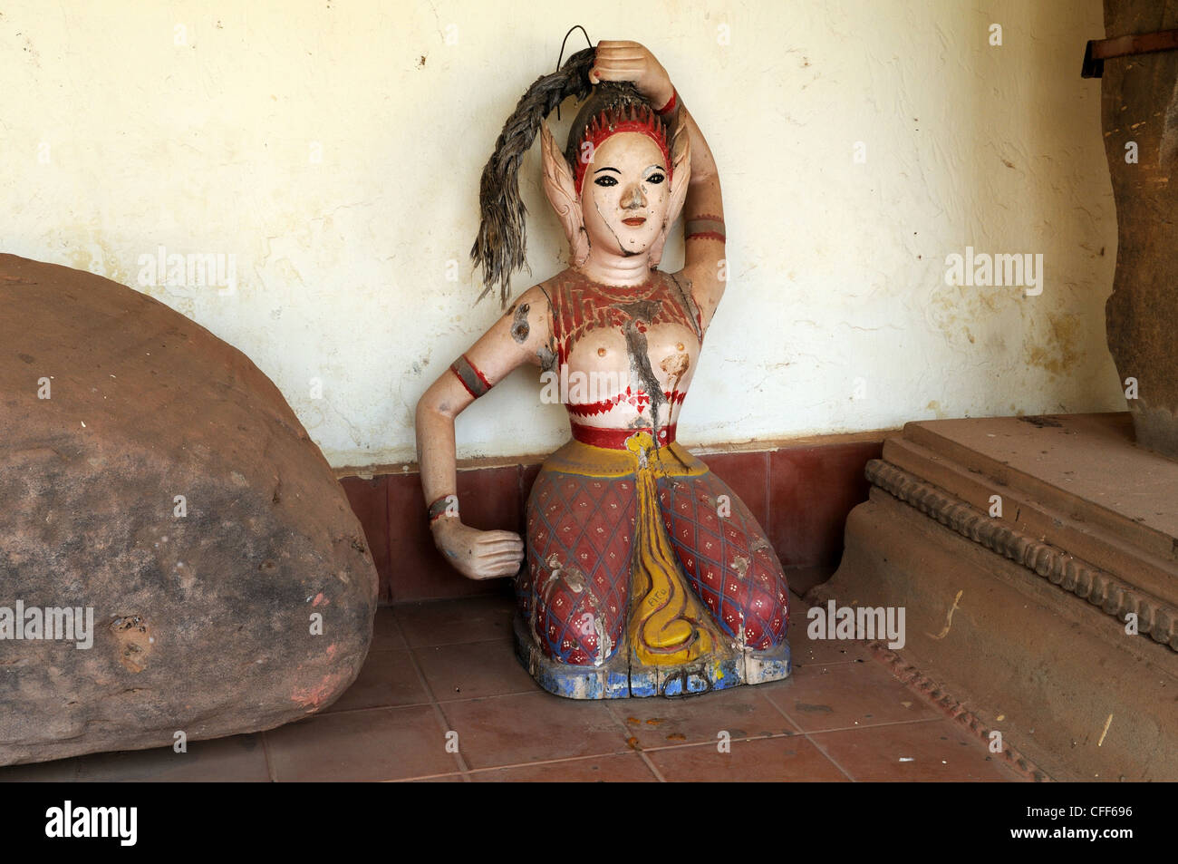 Ancient statue of Buddhist Earth Mother Goddess found during the reconstruction of Pha That Luang Vientiane Laos - Stock Image