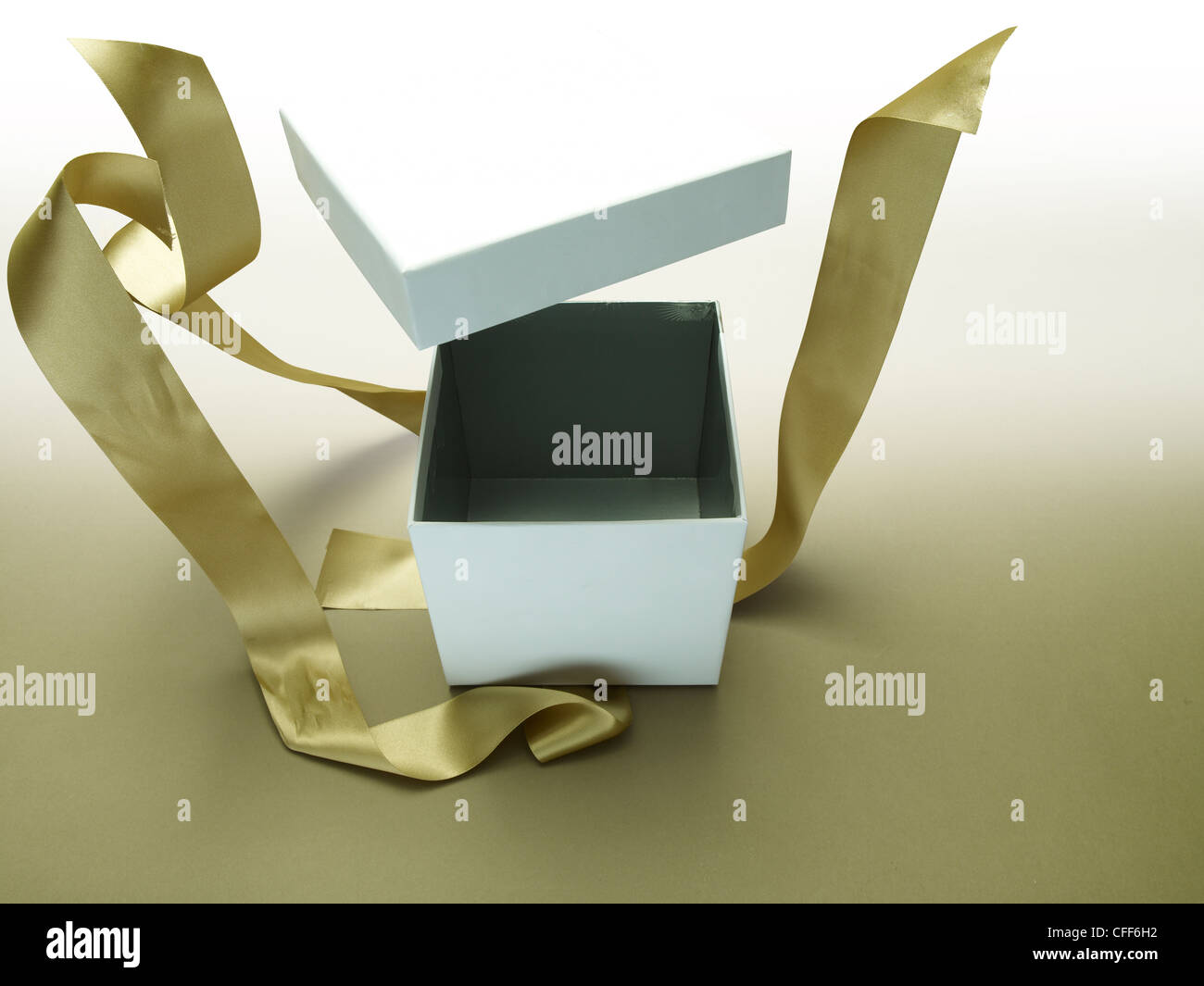 Gift box exploding open - Stock Image