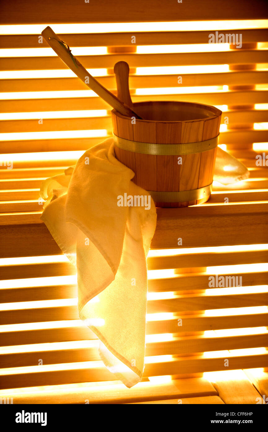 Towel and tub in a sauna, Alto Adige, South Tyrol, Italy, Europe - Stock Image