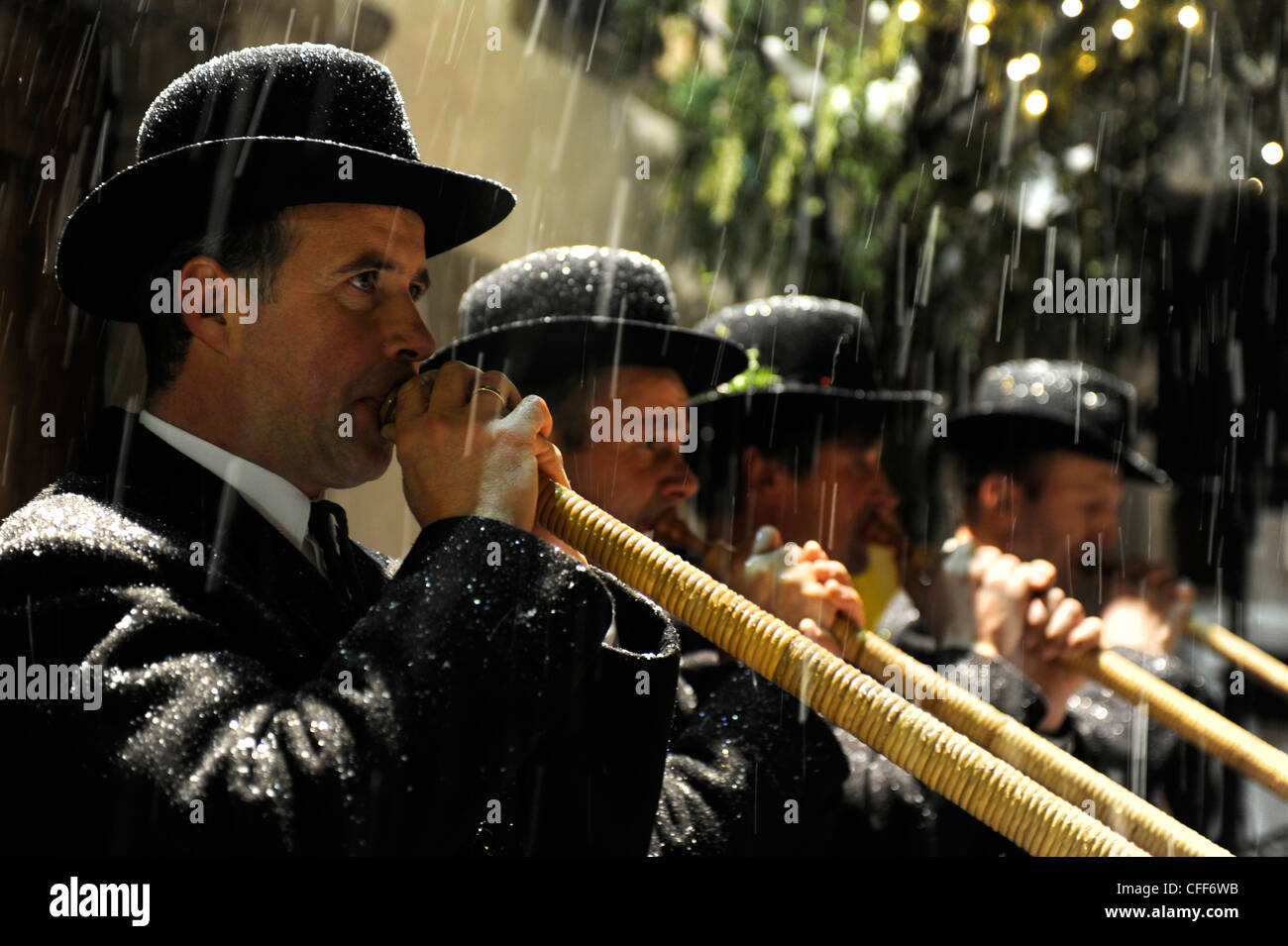 Musicians playing the alphorn in the rain, Alto Adige, South Tyrol, Italy, Europe - Stock Image