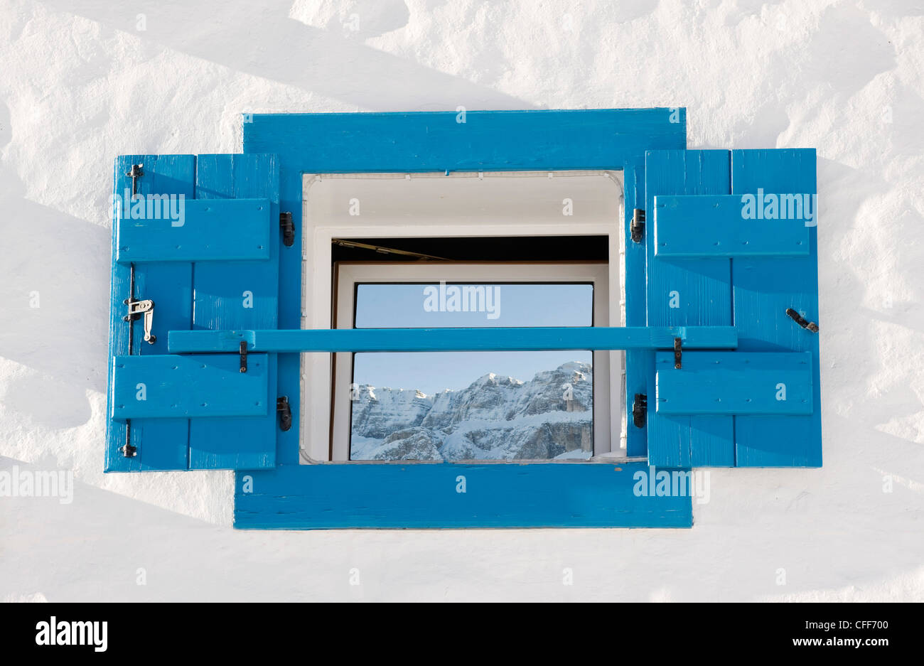 Reflection of snowy mountains on a window pane, Alto Adige, South Tyrol, Italy, Europe - Stock Image