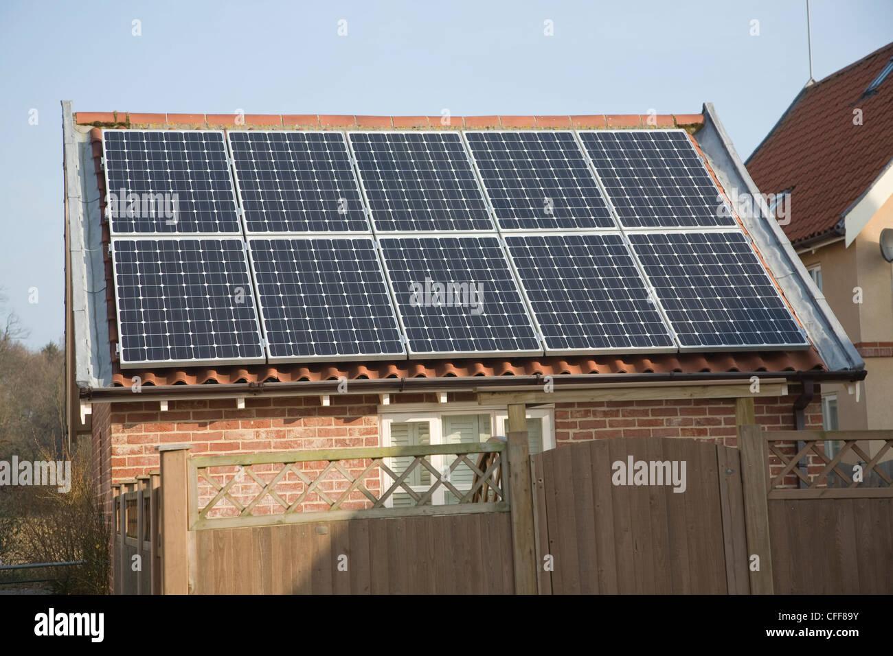 Domestic solar panel array on garage roof - Stock Image