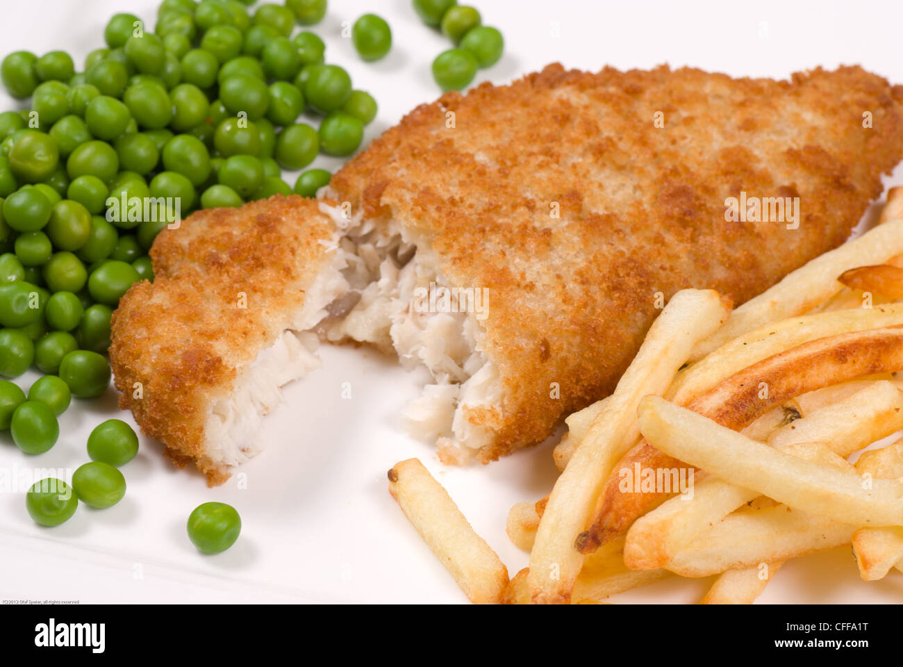 Classic English fish and chips served with peas - Stock Image