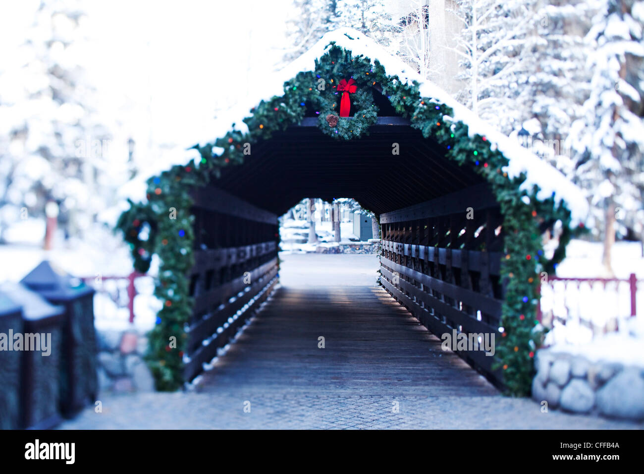 A athletic skier walking into a snowy covered walkway in Colorado. - Stock Image