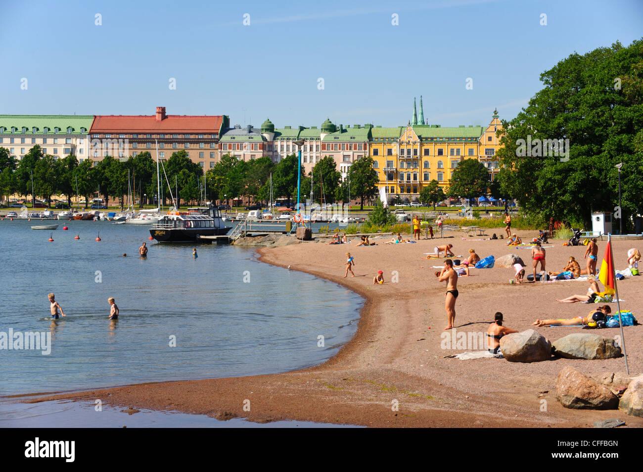 Beach on Unisaari island, looking towards the Merisatama quayside, Helsinki Finland - Stock Image