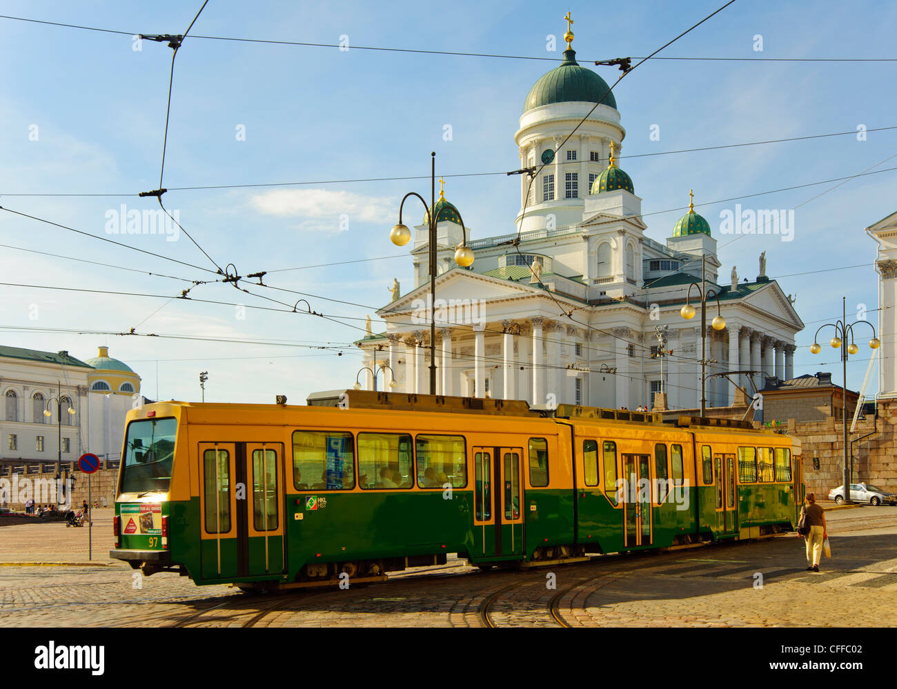 Tram passing in front of the Lutheran Cathedral (Tuomiokirkko) in Helsinki Finland - Stock Image