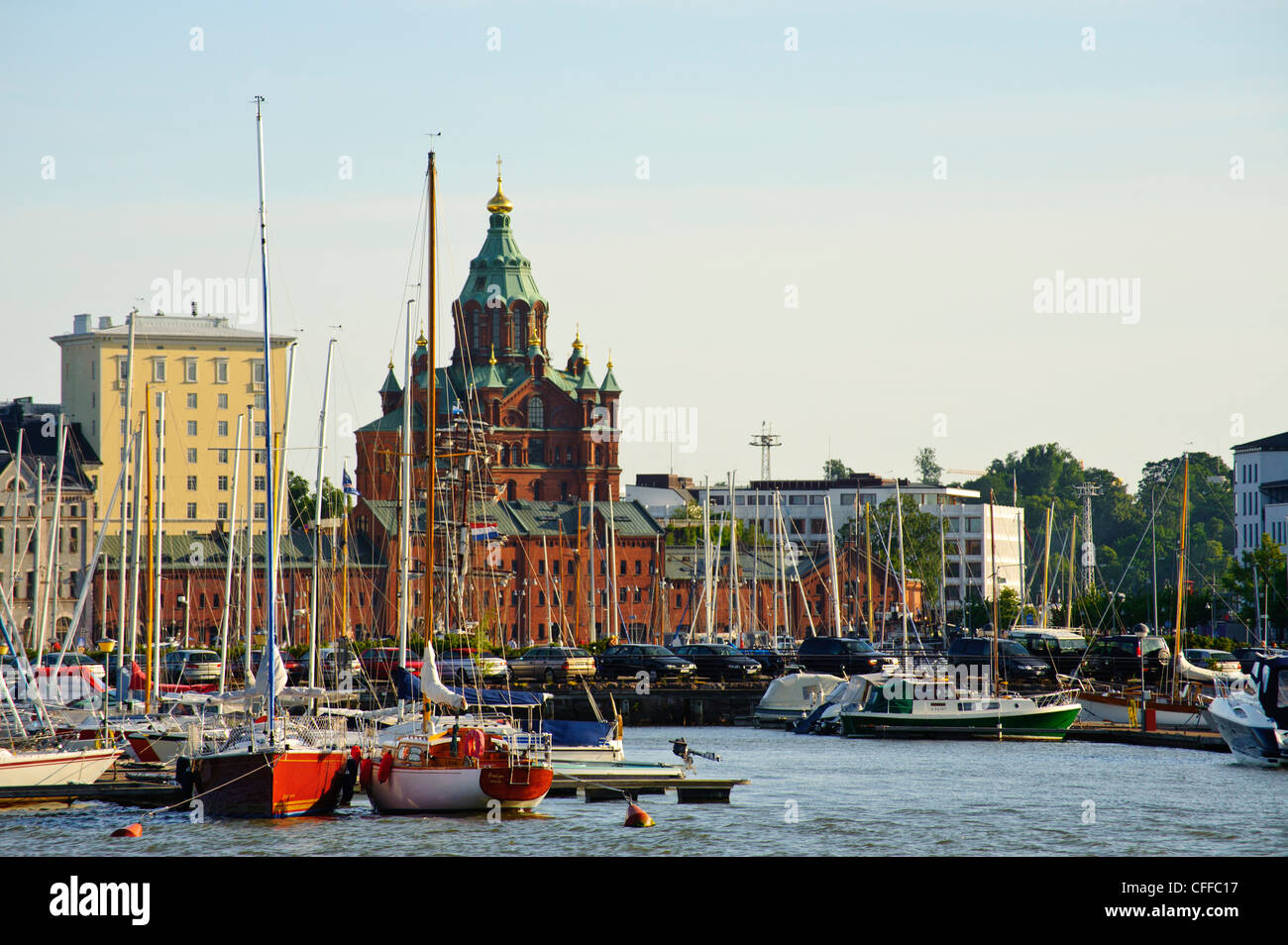 The Orthodox or Uspenski Cathedral rising above Halkolaituri harbour Helsinki Finland - Stock Image
