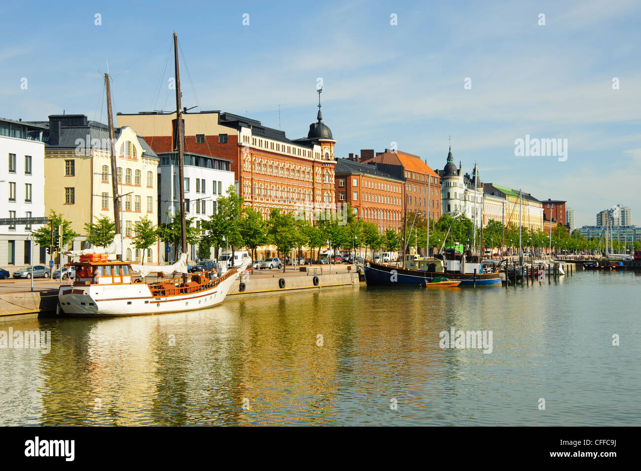 Boats at Halkolaituri Helsinki Finland with the street frontage of Pohjoisranta behind - Stock Image