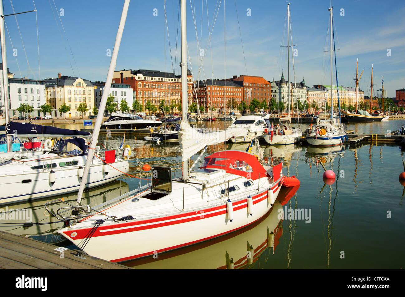 Yachts at Halkolaituri Helsinki Finland with the street frontage of Pohjoisranta behind - Stock Image