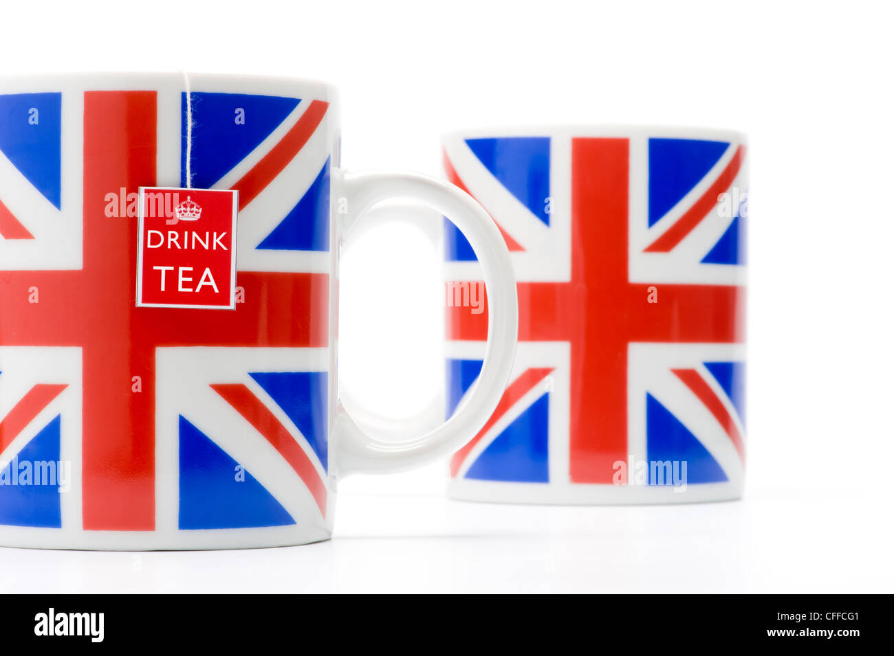 Two Union Jack mugs with teabag string, shot in studio on a white background. - Stock Image