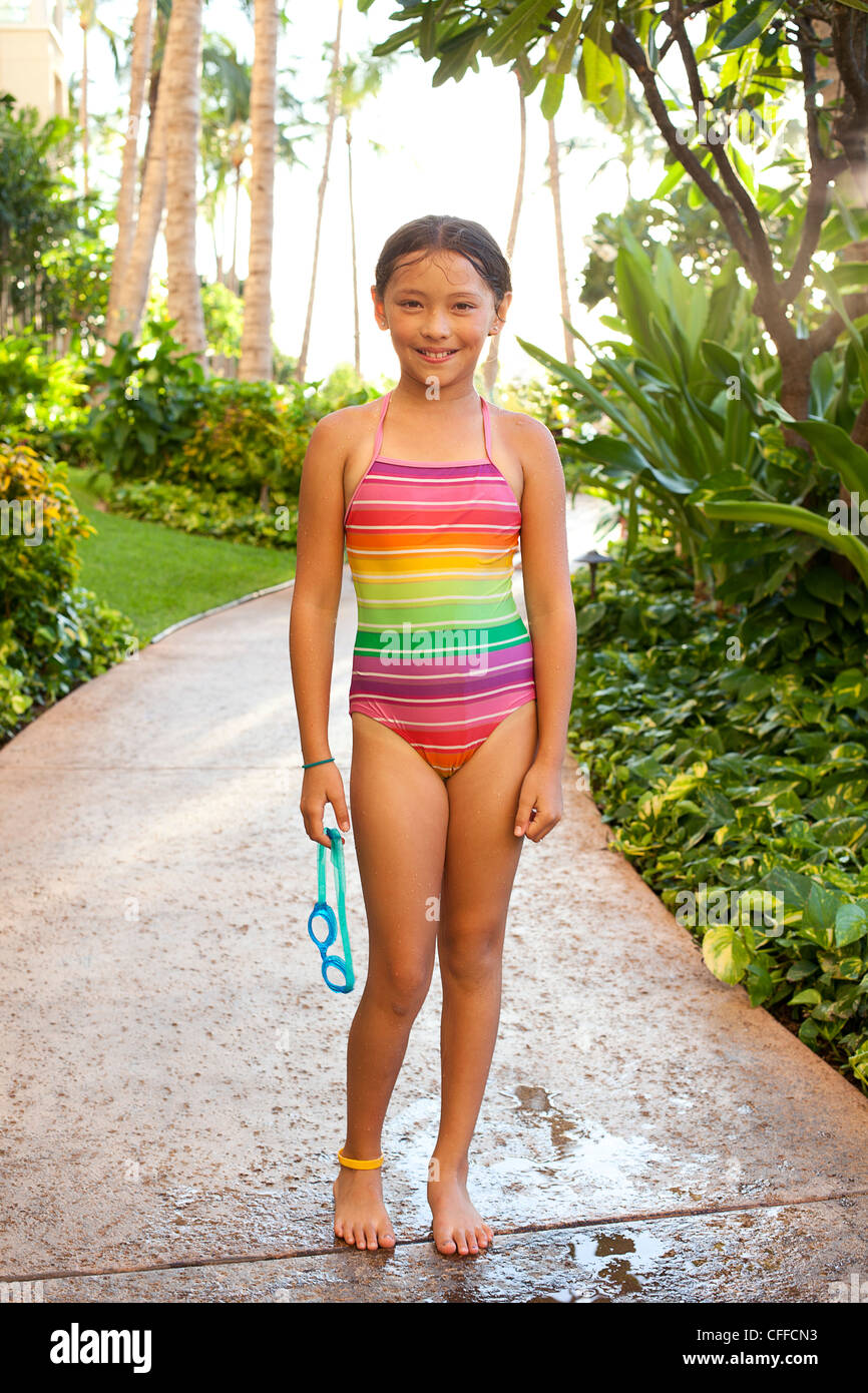 A portrait of a young girl at a hotel resort in Kapolei, Hawaii. - Stock Image
