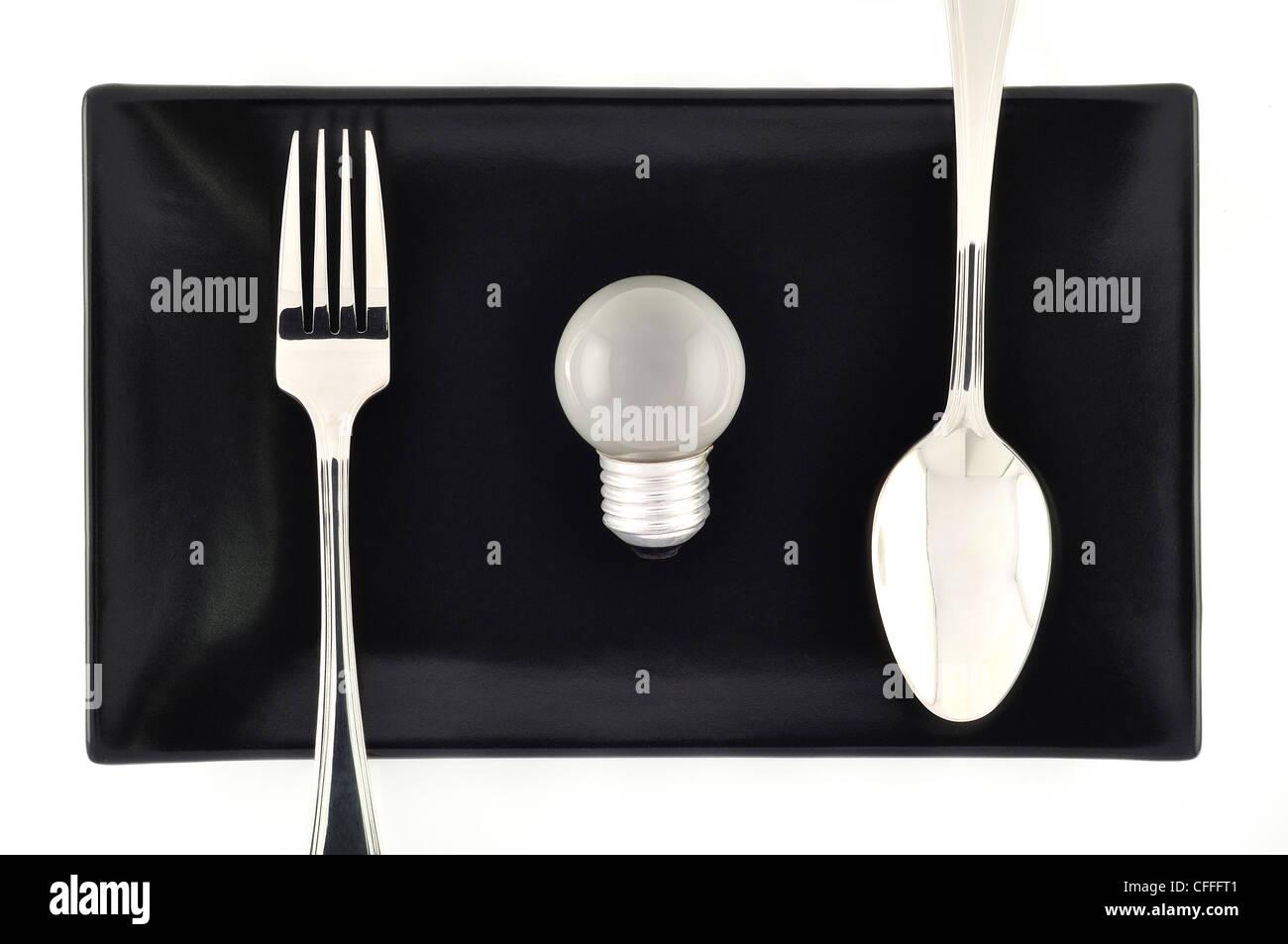 Traditional glass bulb and energy savings - Stock Image