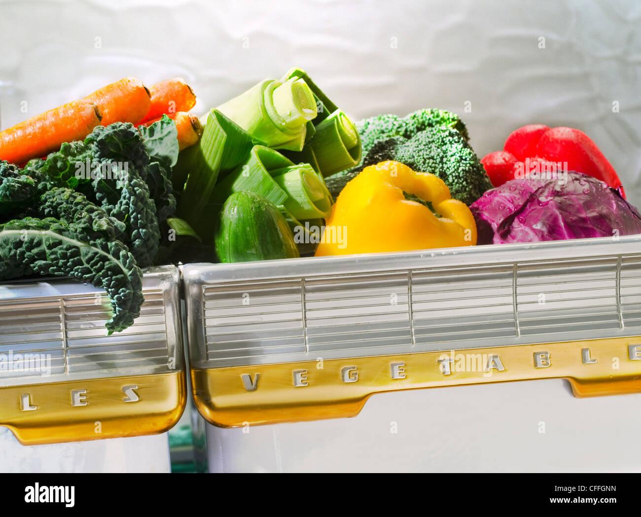 various vegetable in retro refrigerator bin Stock Photo