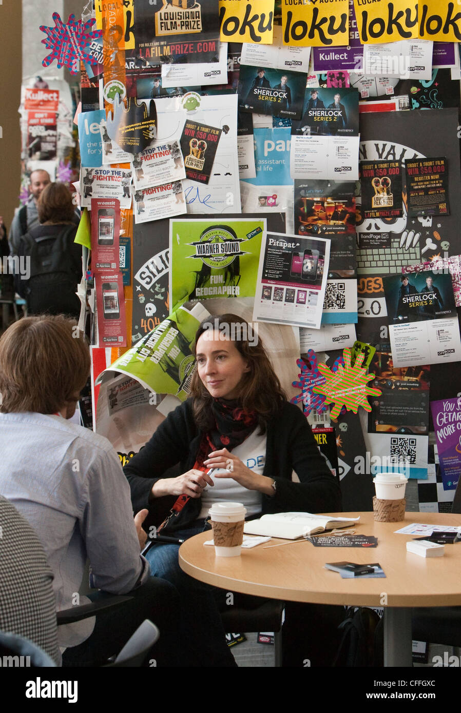 SXSW Interactive convention draws thousands attendees making any wall an opportunity to place marketing flyers - Stock Image