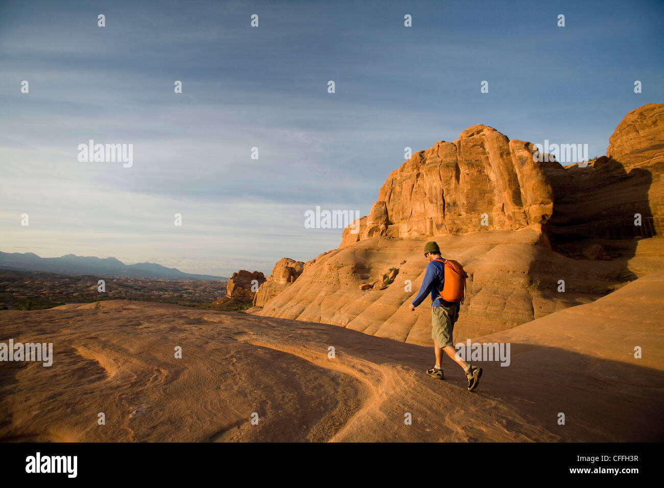 Young man hiking in Arches National Park near Moab, Utah. - Stock Image