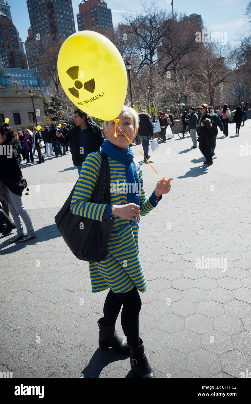 Activists in New York gather in Union Square Park to protest the use of nuclear energy - Stock Image